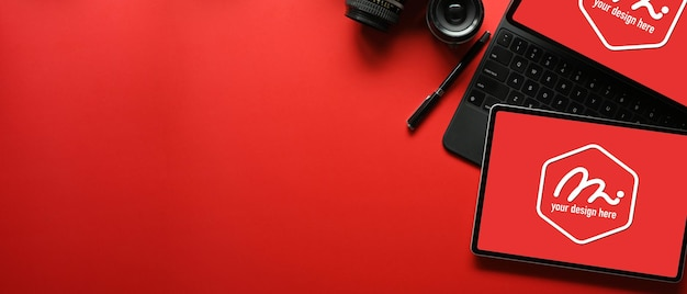 Top view of creative flat lay workspace with digital tablets
