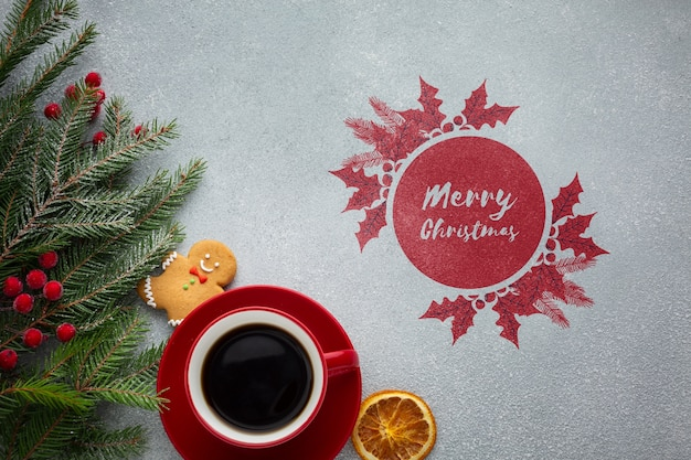 Top view cup of coffee with watercolour merry christmas design