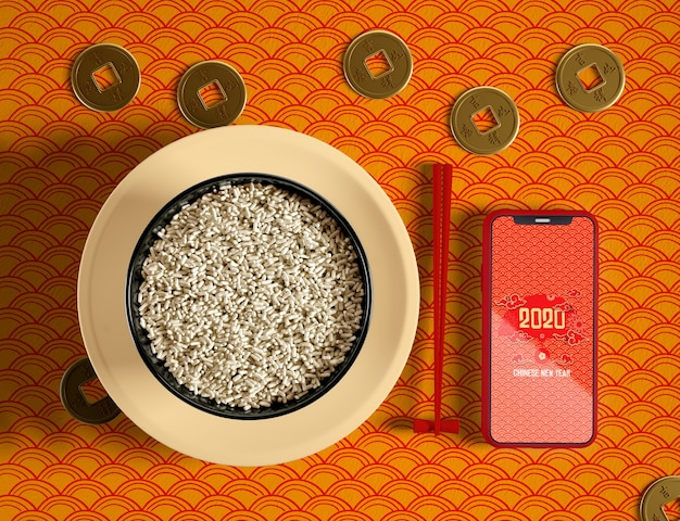 Top view delicious bowl of rice and phone mock-up