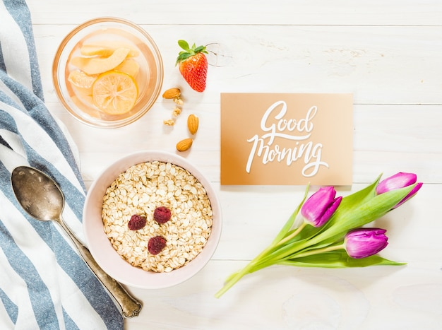Top view delicious breakfast with good morning card