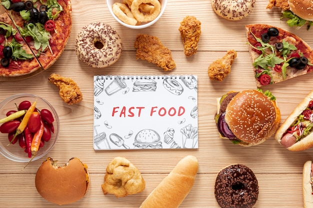 Top view of delicious fast food on wooden table
