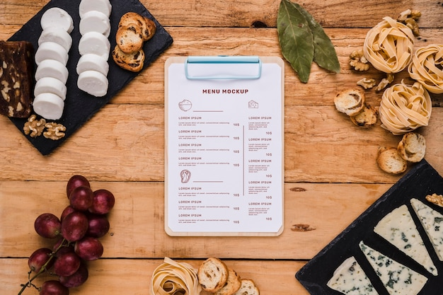 Top view delicious food composition with clipboard mock-up