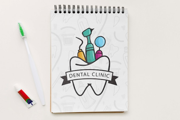 Top view dental clinic notebook with mock-up