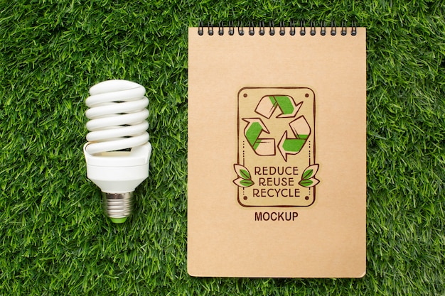 Top view eco notebook mock-up with lightbulb