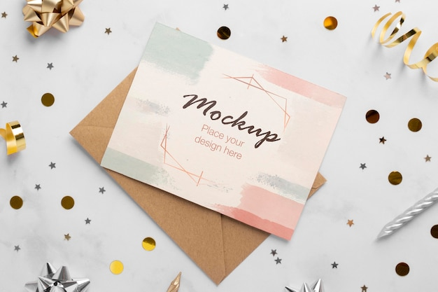 Top view of elegant birthday card with ribbon and confetti
