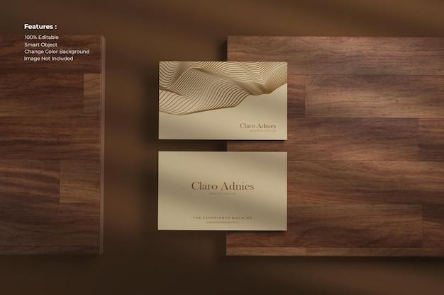 Top view elegant business card mockup on wood