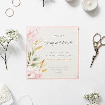 Top view elegant wedding invitation with mock-up