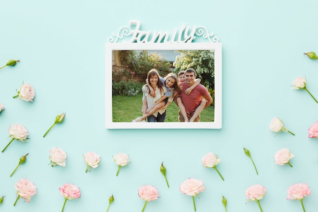 Top view of family frame with spring roses