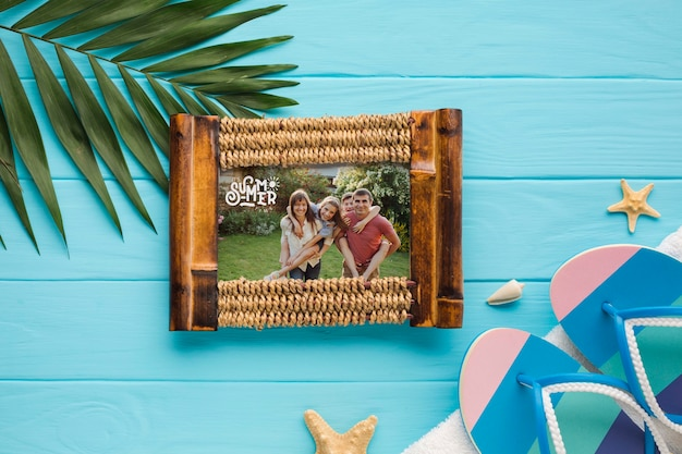 Top view family photo frame with flip flops on the table