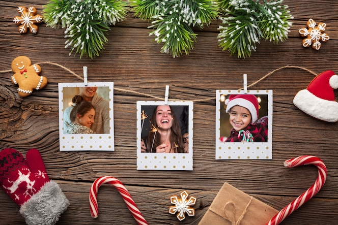 Top view family photos on wooden background