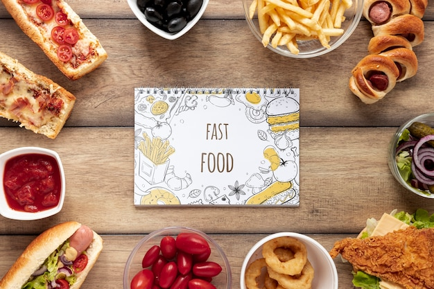Top view of fast food mock-up on wooden table