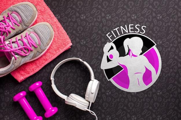 Top view fitness equipment and headphones