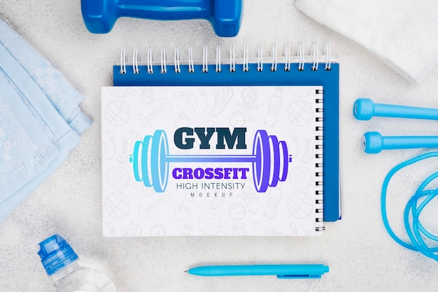 Top view of fitness notebook with jumping rope and pen
