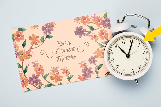Top view of floral card with clock