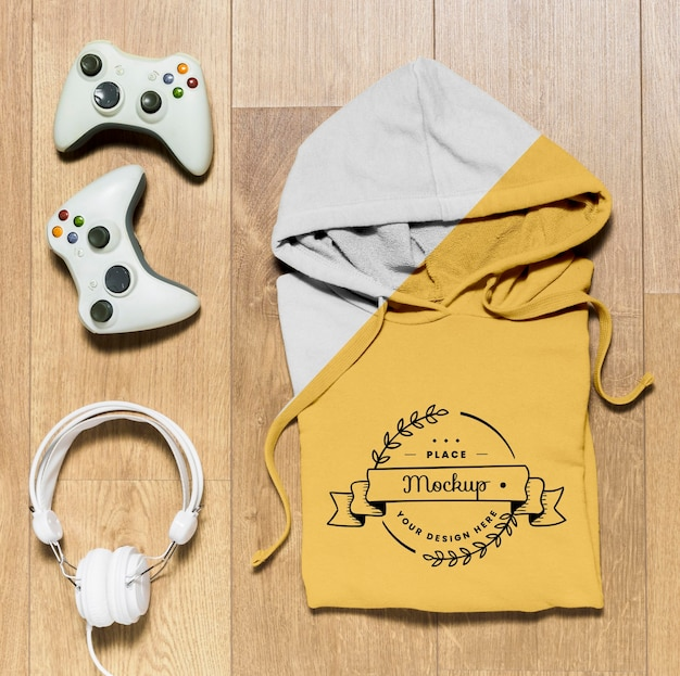 Top view folded hoodie mock-up with controllers and headphones