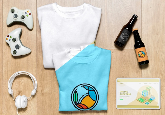 Top view folded hoodies mock-up with gadgets and bottles