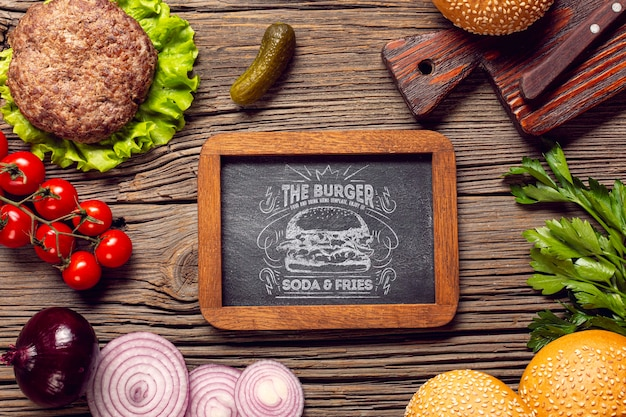 Top view frame burger ingredients wooden background