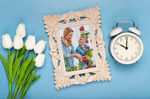 Top view of frame with clock and tulips
