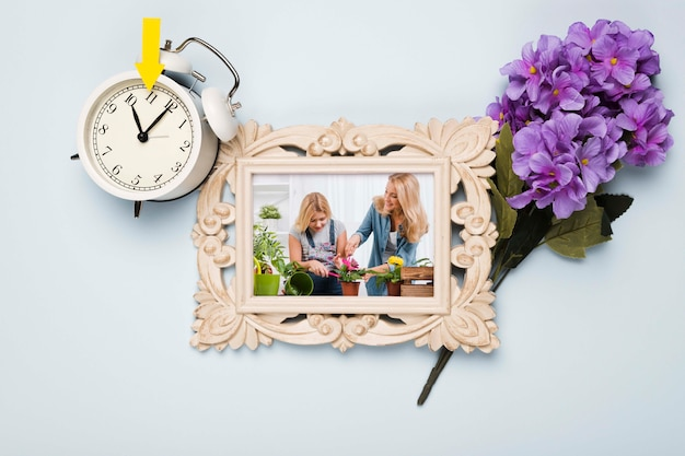 Top view of frame with flowers and clock