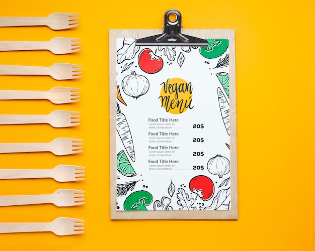 Top view free food delivery assortment with clipboard mock-up