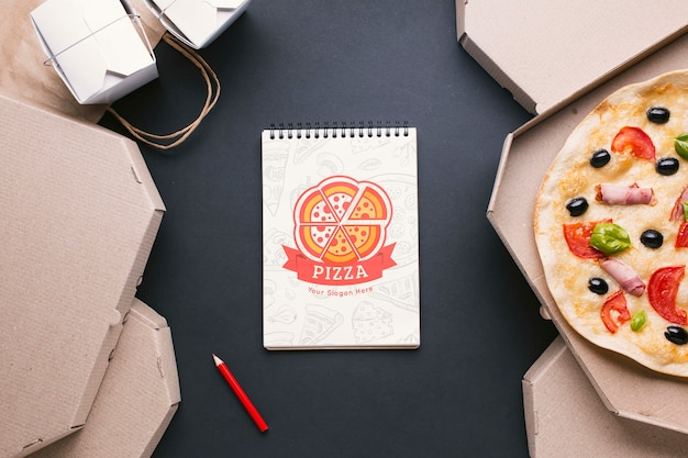 Top view free food service assortment with notepad mock-up
