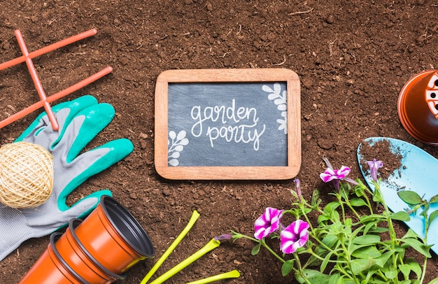 Top view gardening tools and wooden frame
