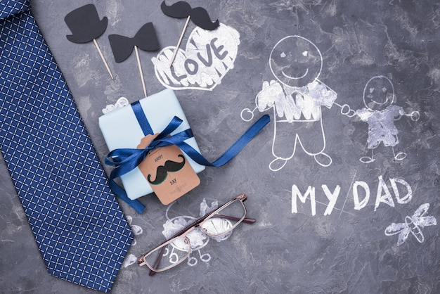 Top view of gift and tie with glasses for fathers day