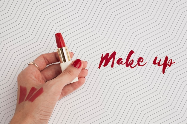 Top view of hand and lipstick mock-up