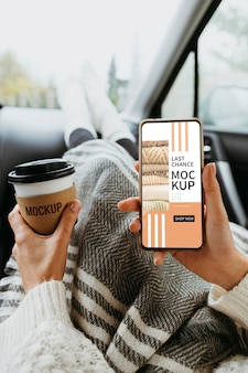 Top view on hand with smartphone mockup and cup of coffee