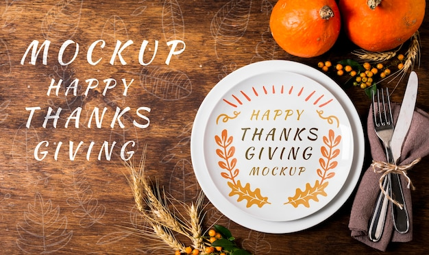 Top view happy thanksgiving with plate and cutlery mock-up