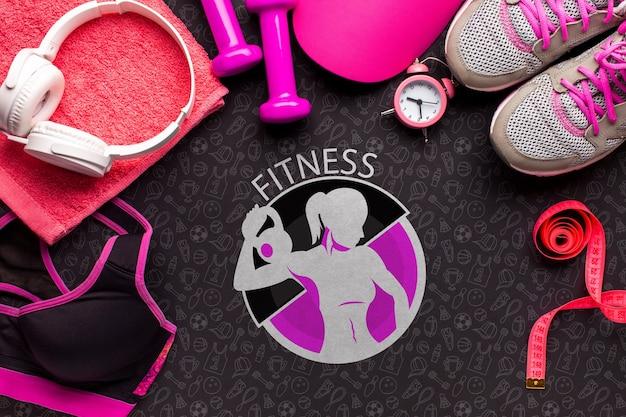 Top view headphones and fitness equipment