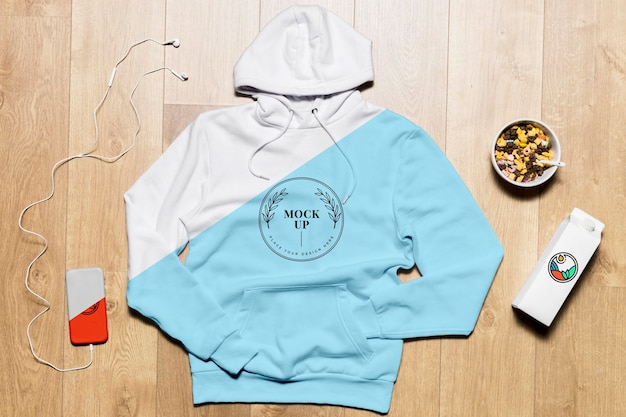 Top view hoodie mock-up with phone and snack