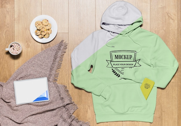 Top view hoodie mock-up with snack and tablet
