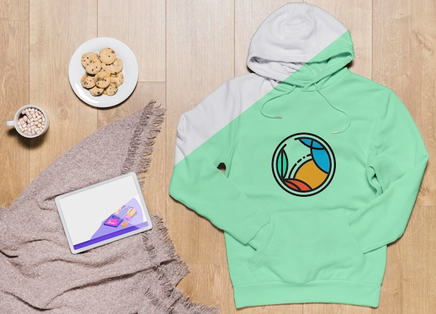 Top view hoodie mock-up with tablet and snack