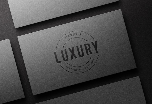 Top view logo mockup on silver business card with letterpress effect