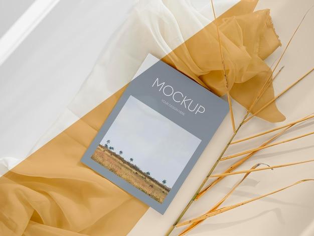 Top view magazine mockup on cloth piece