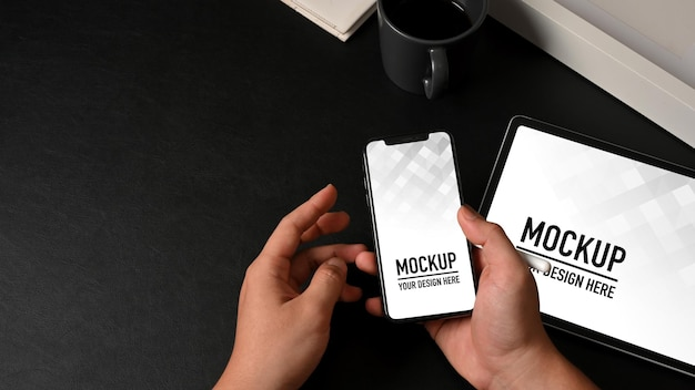 Top view of male hands holding smartphone mockup