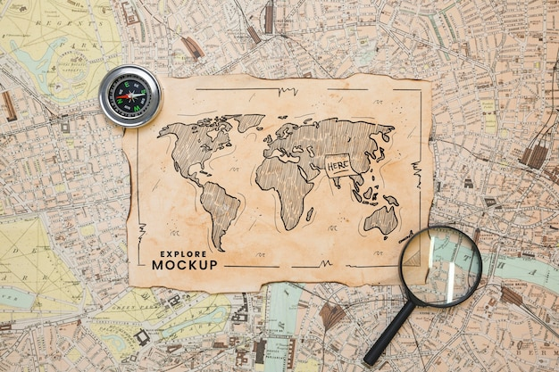 Top view of map with magnifying glass and compass for traveling