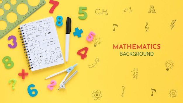 Top view of mathematics background with notebook and numbers