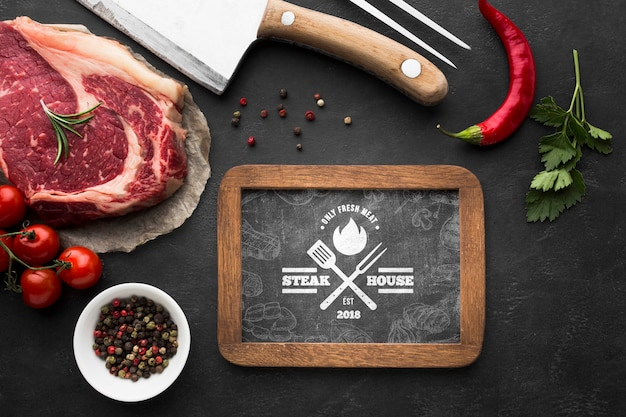 Top view meat products with chalkboard mock-up