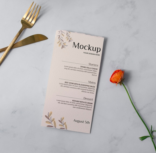 Top view menu, cutlery and flower