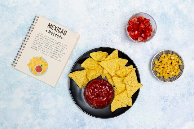 Top view of mexican restaurant food with nachos and corn