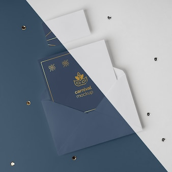 Top view of minimalistic carnival invitation in envelope