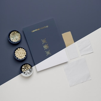 Top view of minimalistic carnival invitation with selection of beads