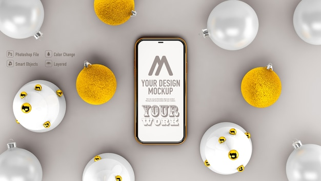 Top view of mobile mockup next to christmas decoration isolated