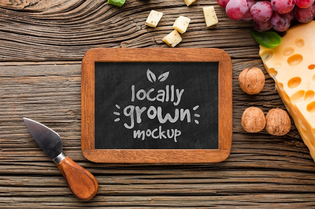 Top view of mock-up blackboard with locally grown cheese Free Psd
