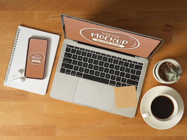 Top view of mock up digital devices with laptop, smartphone, coffee cup, stationery and accessories