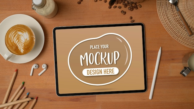 Top view of mock up tabletop wooden table with coffee cup, stationery, accessory and decorations