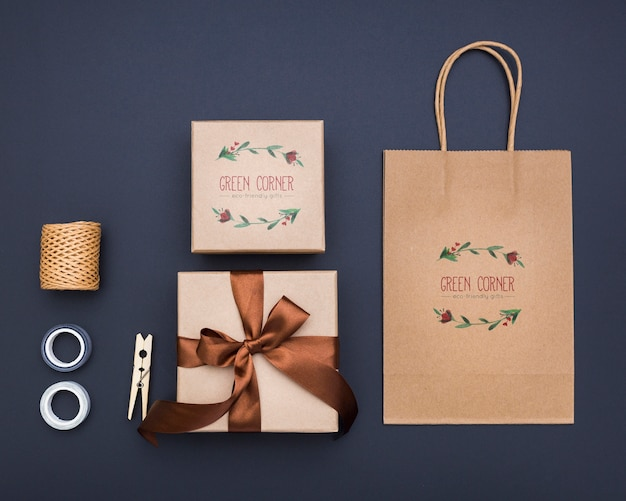 Top view mock-up wrapped gifts and shopping bag