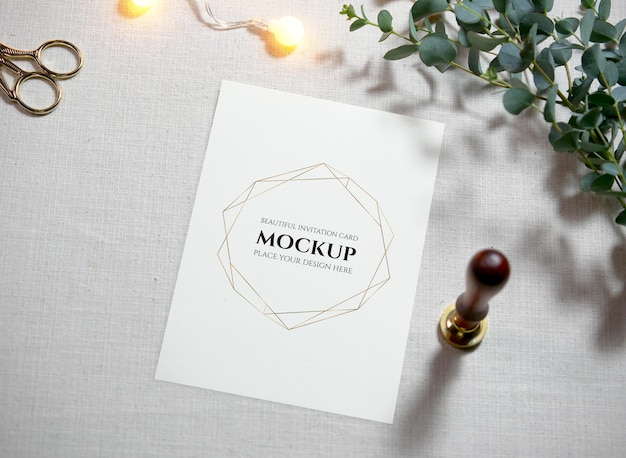 Top view mockup blank card on cloth background